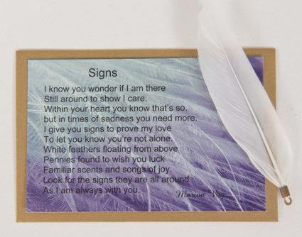 Signs. Card with White Feather Charm.